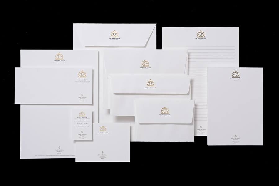 Logo and gold foiled stationery for Ten Trinity Square designed by Pentagram