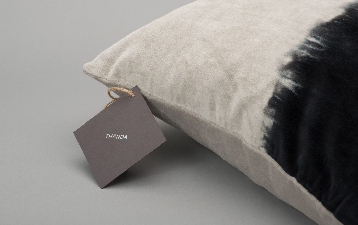 Brand identity and product tags by UK graphic design studio Karoshi for conscientious interior accessory business Thanda
