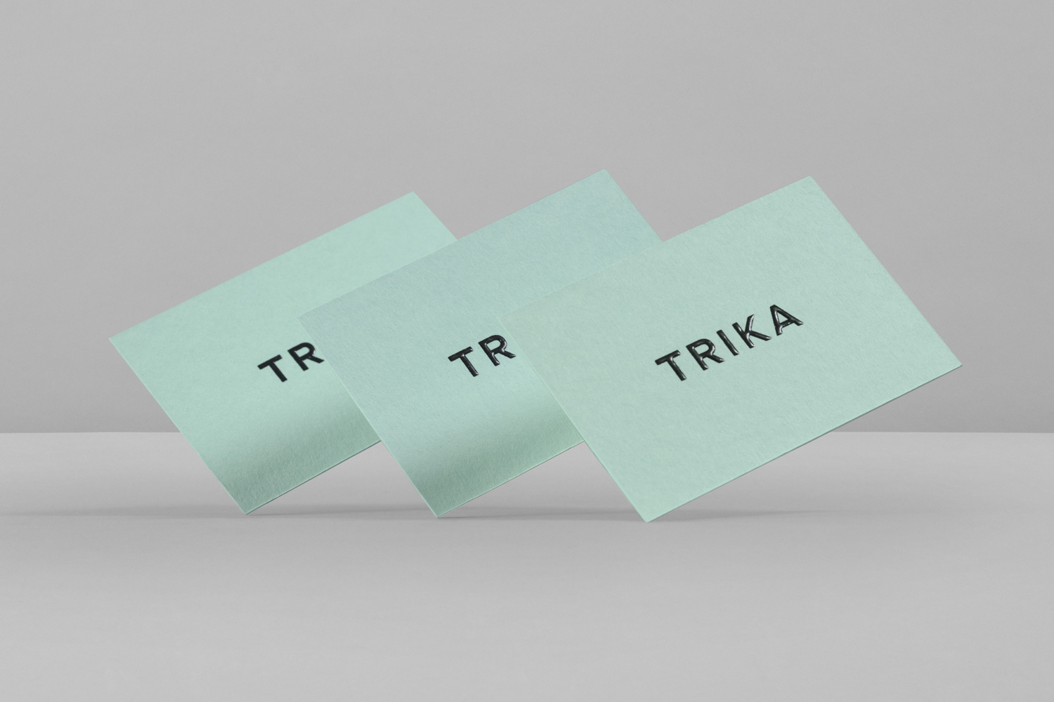Brand identity and business cards with a thermographic ink print finish by UK design studio Bunch for Croatian interior design business Trika