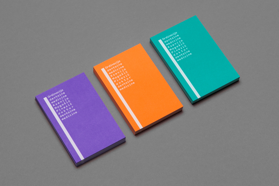 Business card design with white ink and coloured paper detail for dental practice KMP by Studio 8585