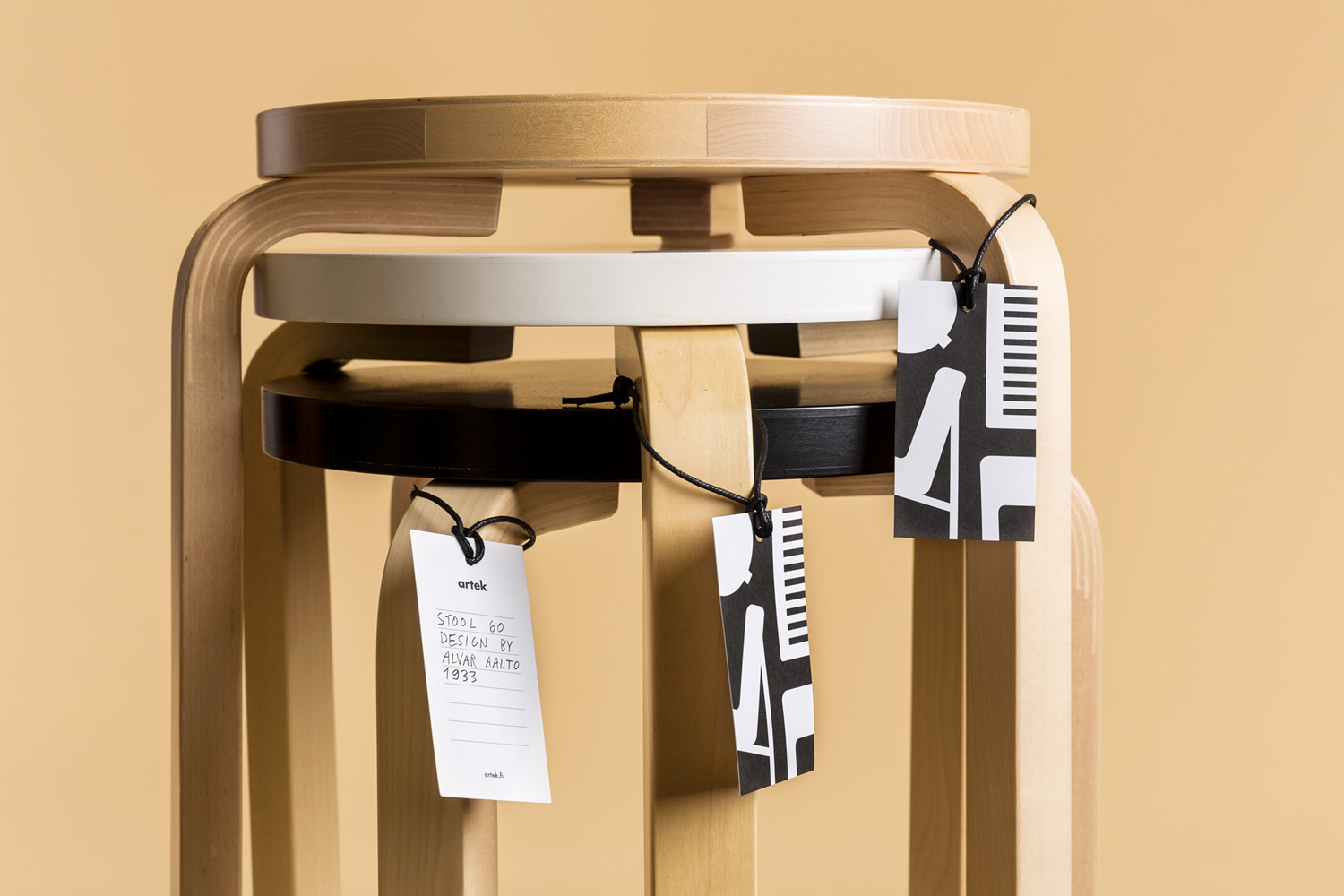 Brand identity and tags by graphic design studio Tsto for furniture and homeware store Artek Helsinki.