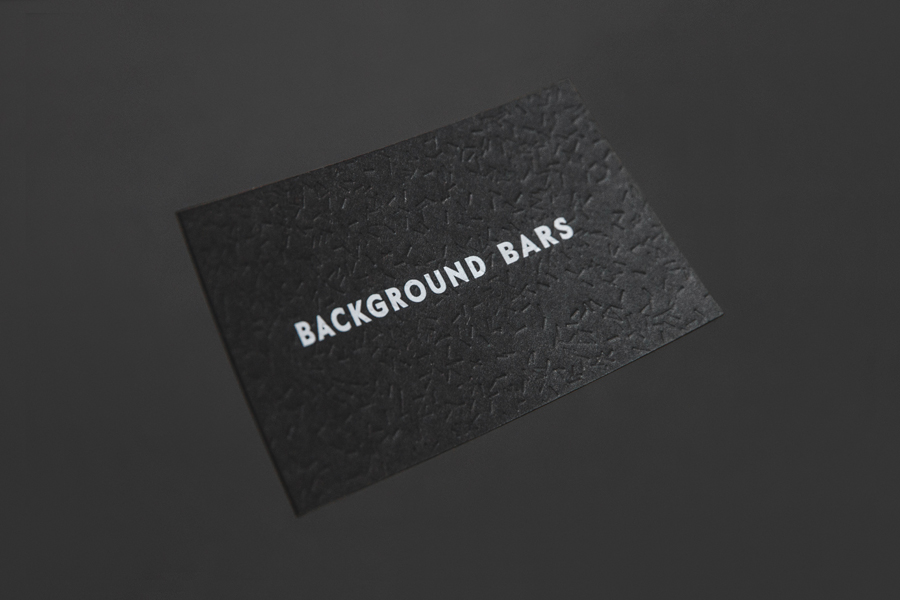 Blind embossed black board business card for Background Bar by Campbell Hay