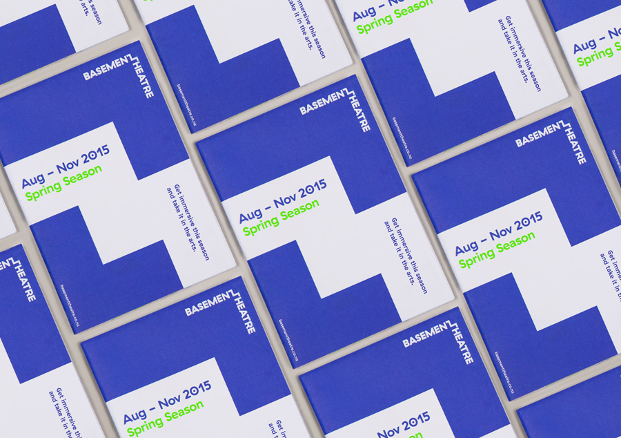 Programme with neon ink detail for Basement Theatre by graphic design agency Studio Alexander