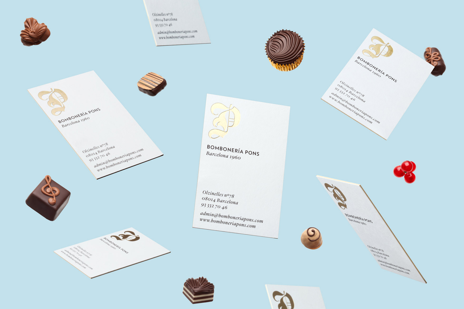 Brand identity and gold foiled and edge painted business cards for chocolatier and confectioner Bombonería Pons designed by Mucho