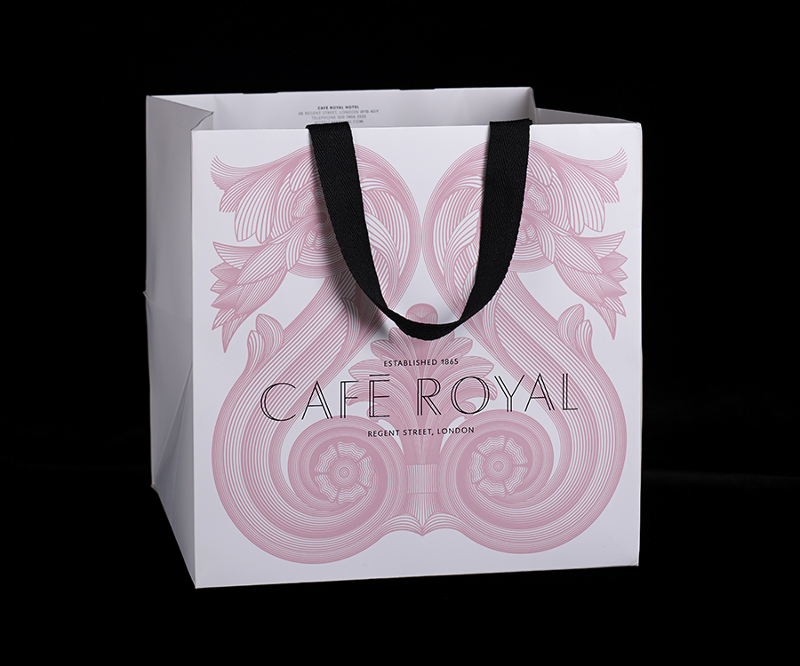 Carrier bag with illustrative detail for Cafe Royal designed by Pentagram