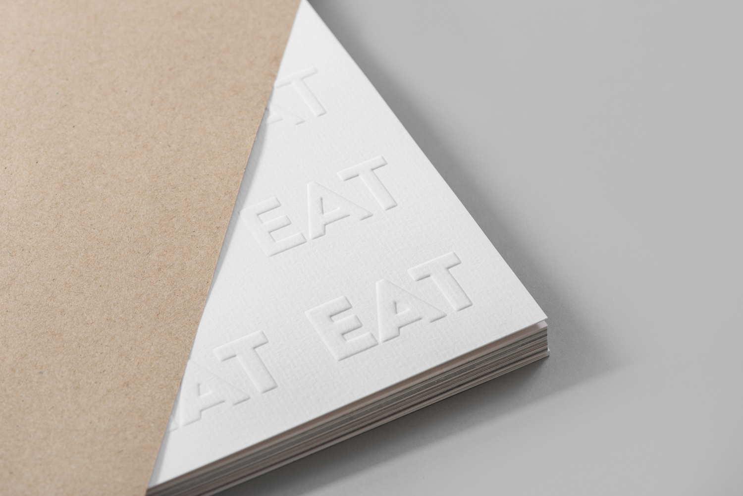 Catalogue with blind emboss detail by Fable for EAT, the second installation of a two-year long series of exhibitions on Singapore's food culture