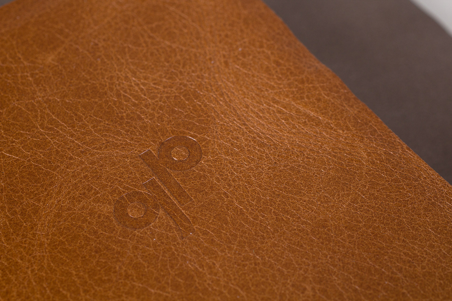 Tan leather-bound and embossed notebook for Generation Press designed by Build