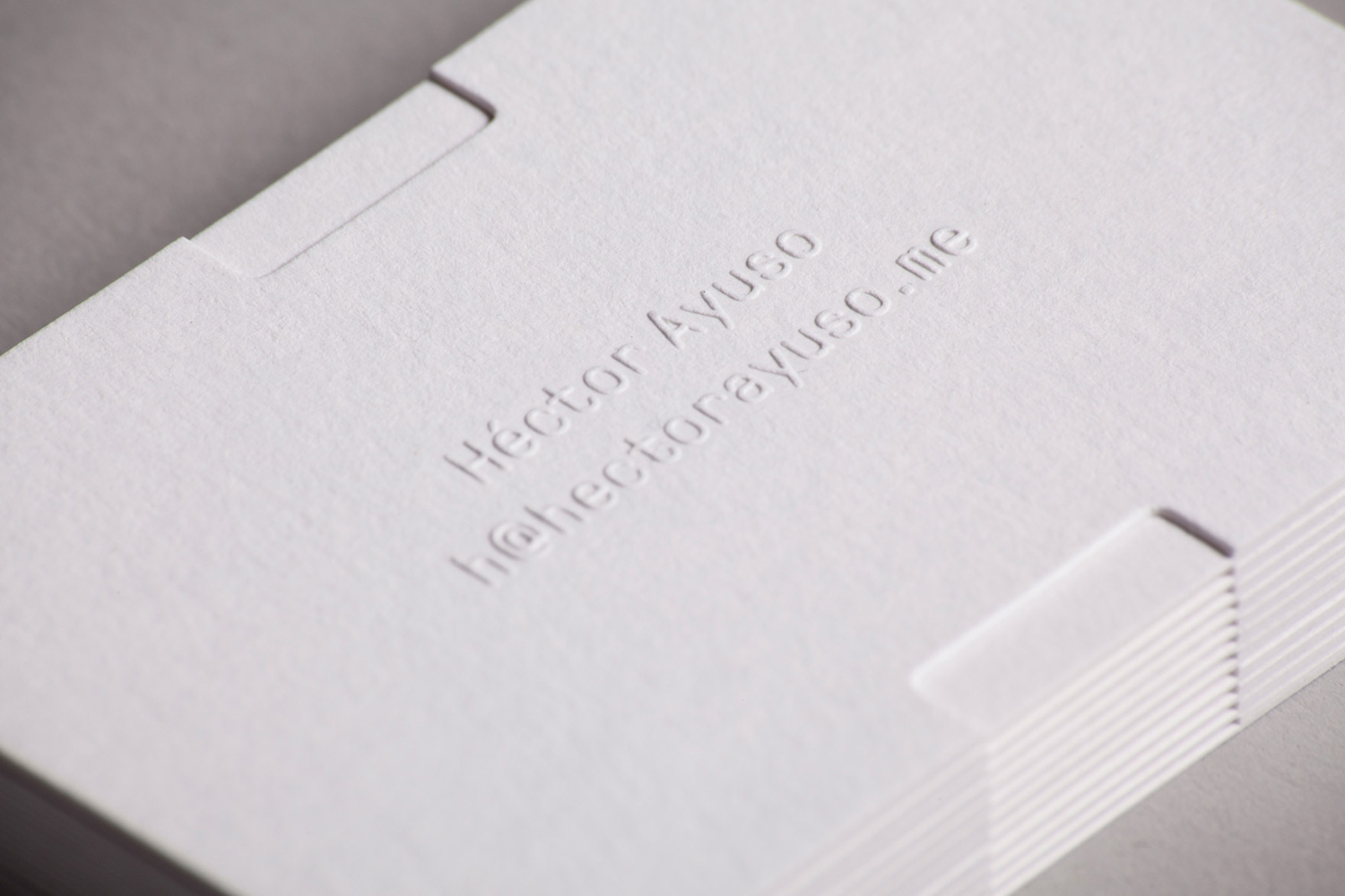 Blind emboss business card for Héctor Ayuso designed by Mucho