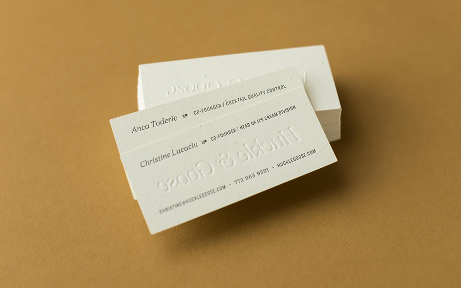 Logotype and blind embossed business card design by Cast Iron for seasonal meal advisor Huckle & Goose