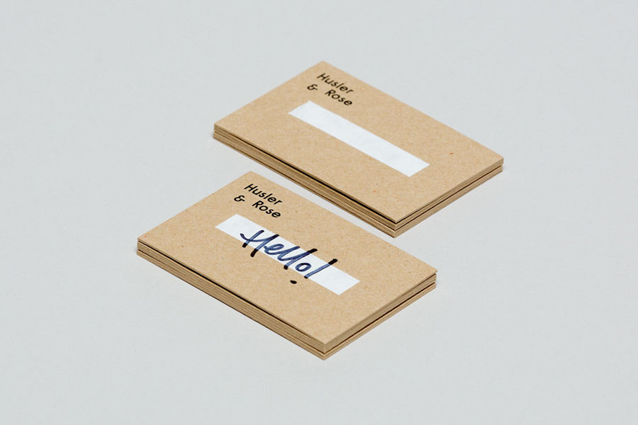 Uncoated, unbleached, white ink and black foiled business cards for Husler & Rose designed by Post