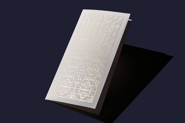 Brand identity and gold foiled menu by Austrian graphic design studio Seite Zwei for Graz-based restaurant Landhaus Keller.