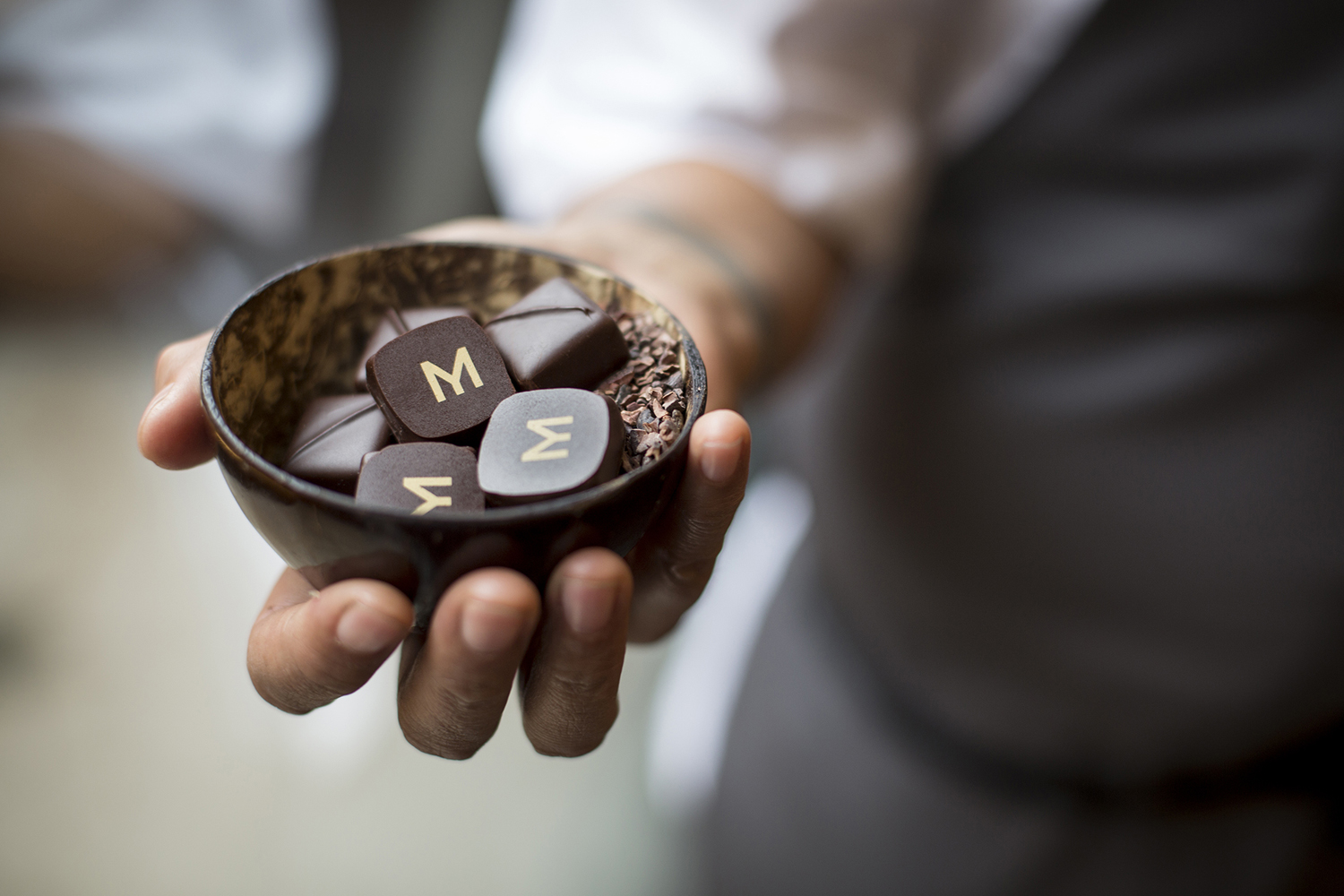 Logo and branded chocolates designed by Bibliothèque for Monica Galetti's new London restaurant Mere
