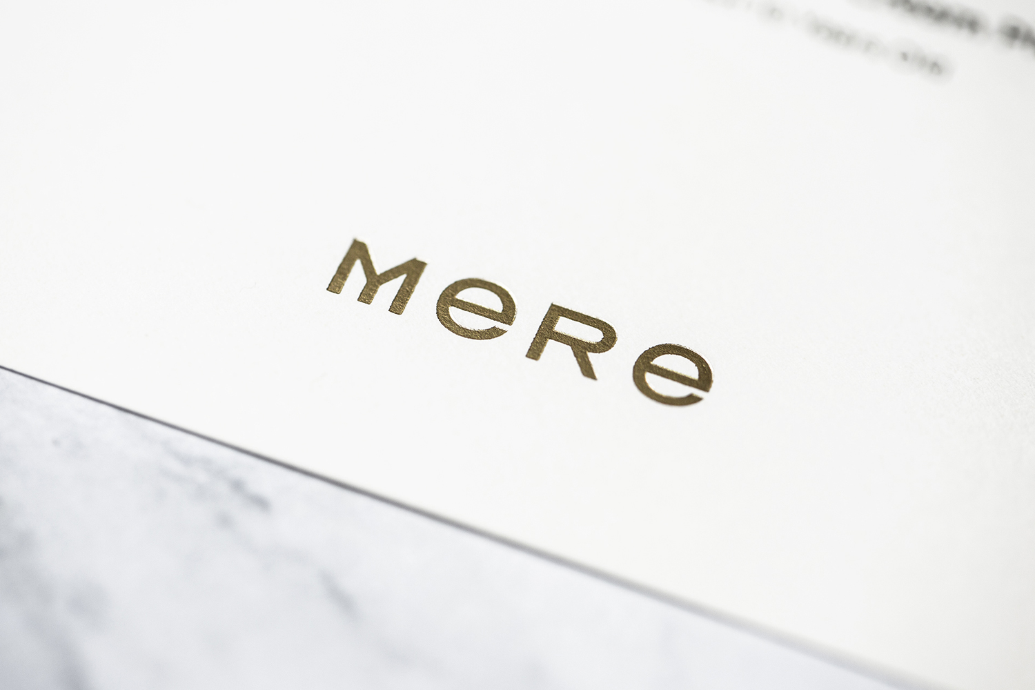Gold block foiled logotype designed by Bibliothèque for Monica Galetti's new London restaurant Mere