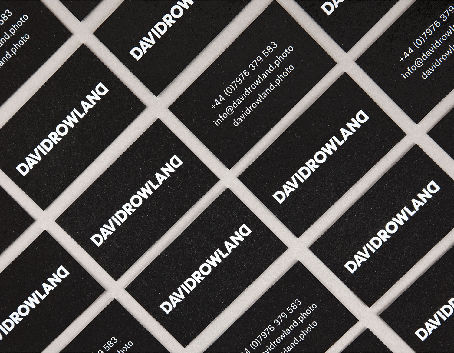 Logotype and black business cards with white ink detail by London-based graphic design studio ico Design for photographer David Rowland