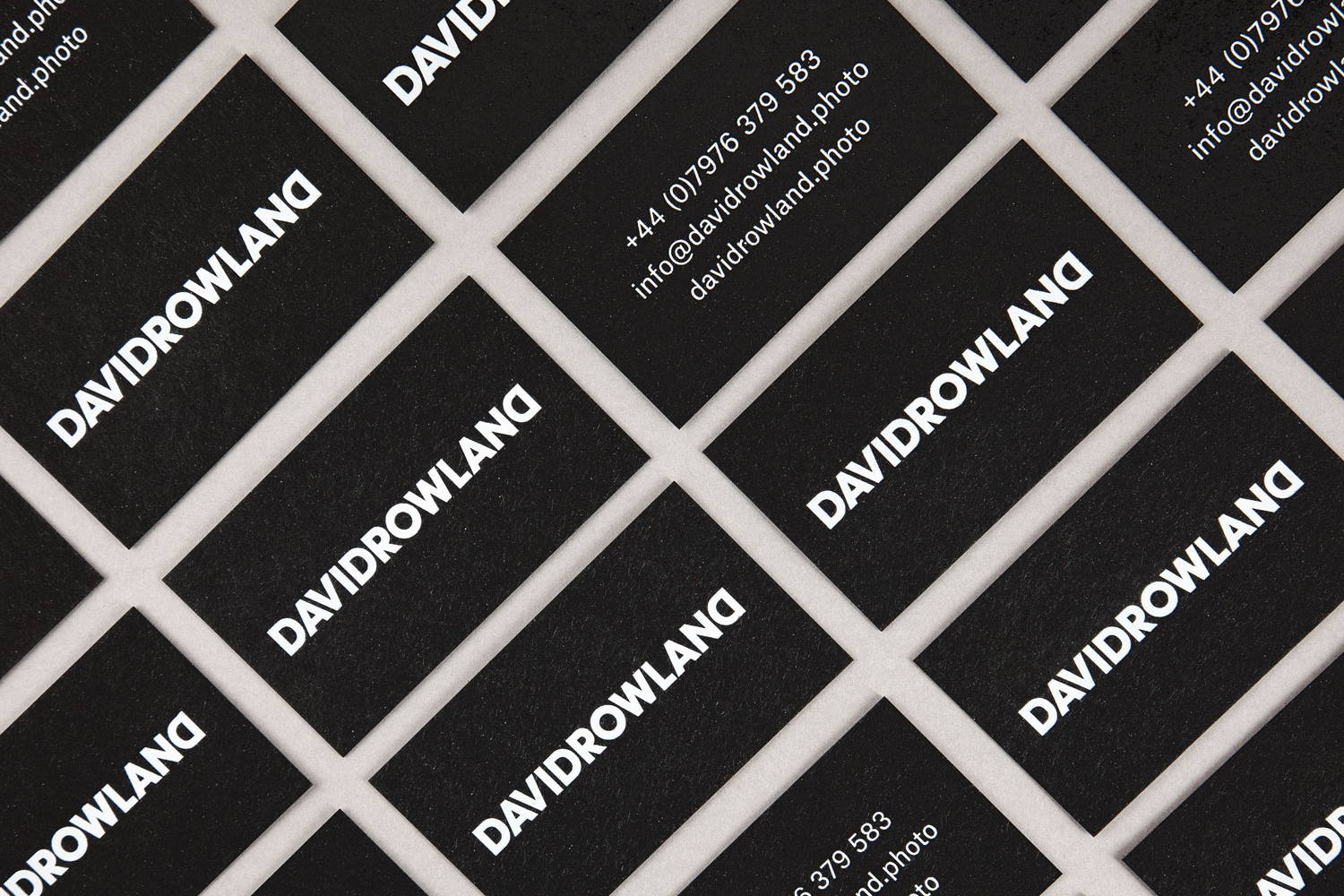 Black business cards with white ink detail by London-based graphic design studio ico Design for photographer David Rowland