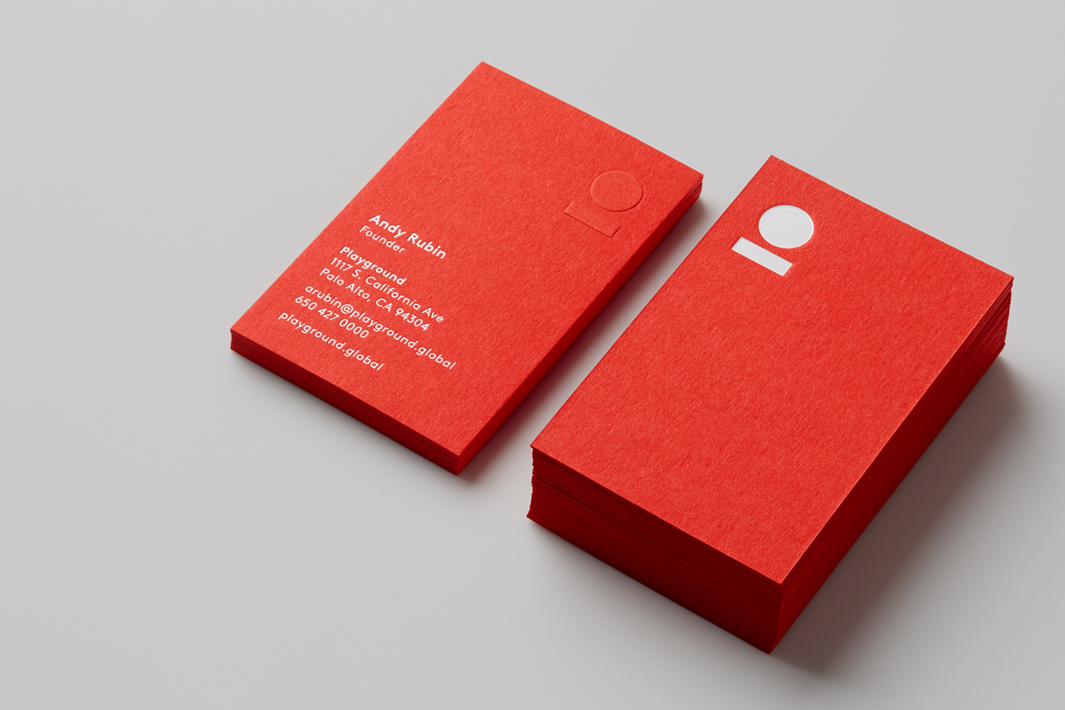 Brand identity and bright red business cards with white foil detail for venture fund and start-up studio Playground by Character