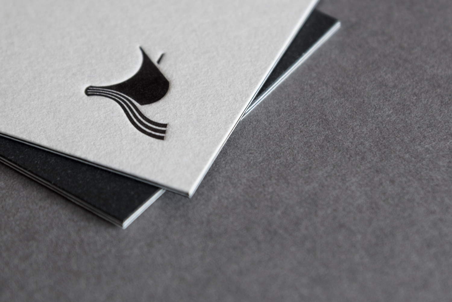 Logo and triplex business cards by London-based design studio, private press and typography workshop The Counter Press for UK independent publisher Rattis Books.