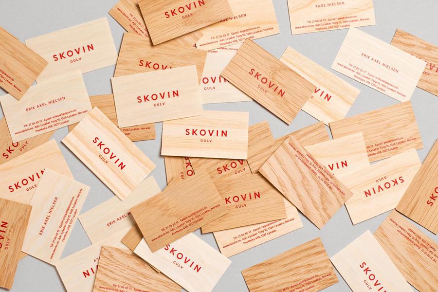 Logotype and wood veneer business card designed by Heydays for Norwegian high-end wood flooring specialist Skovin