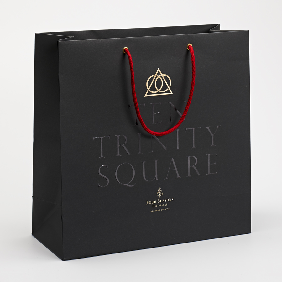 Logo and gold foiled bag for Ten Trinity Square designed by Pentagram