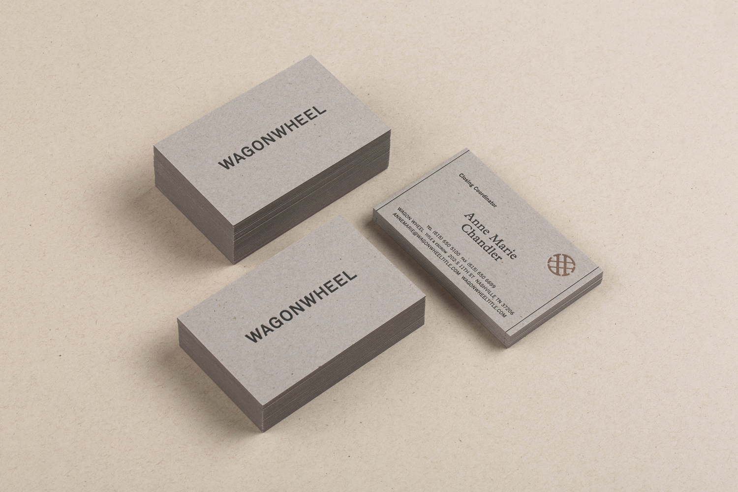 Business card for real estate title and escrow company Wagon Wheel by American studio Perky Bros. These feature black and copper letterpress print finish over an uncoated and unbleached card.