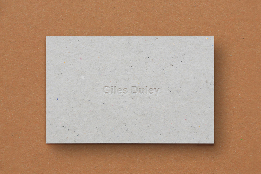 Business card design with unbleached card and blind embossed detail for photographer Giles Duley by Shaz Madani