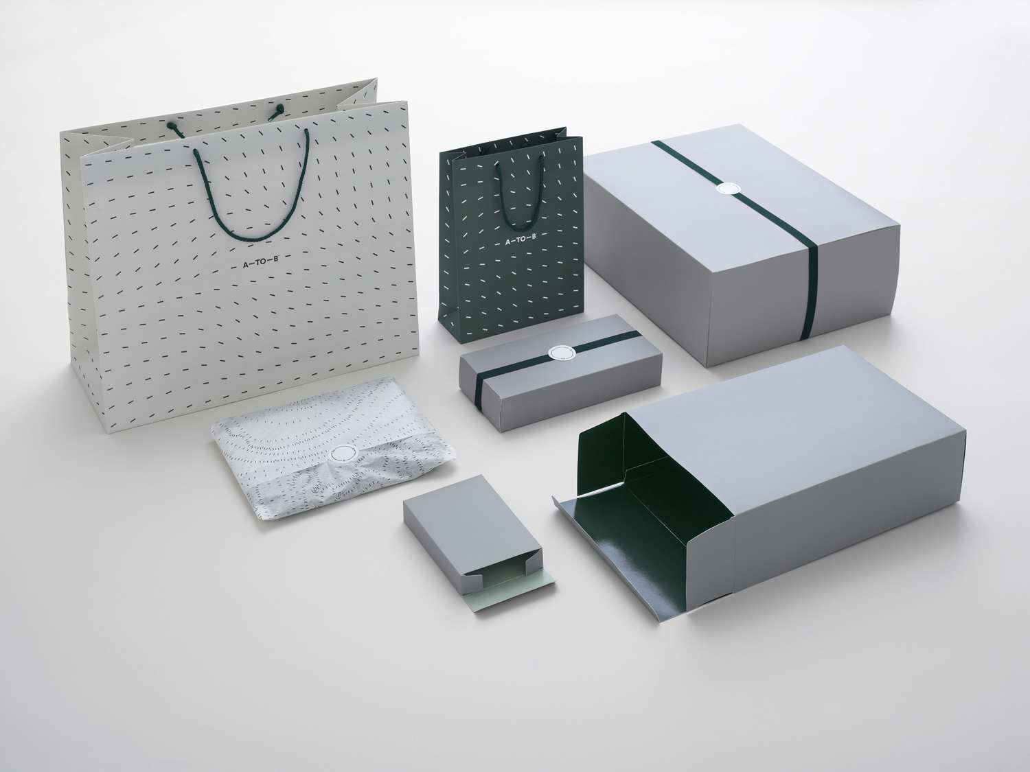 Brand identity, retail packaging and bags for Scandinavian retailer, bag and travel specialist A-TO-B by Stockholm Design Lab