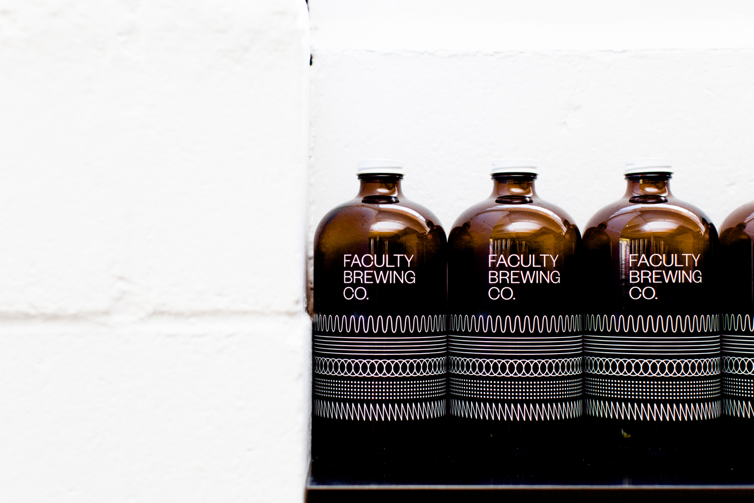 Logotype and screen printed growlers by Canadian graphic design studio Post Projects for Faculty Brewing Co.