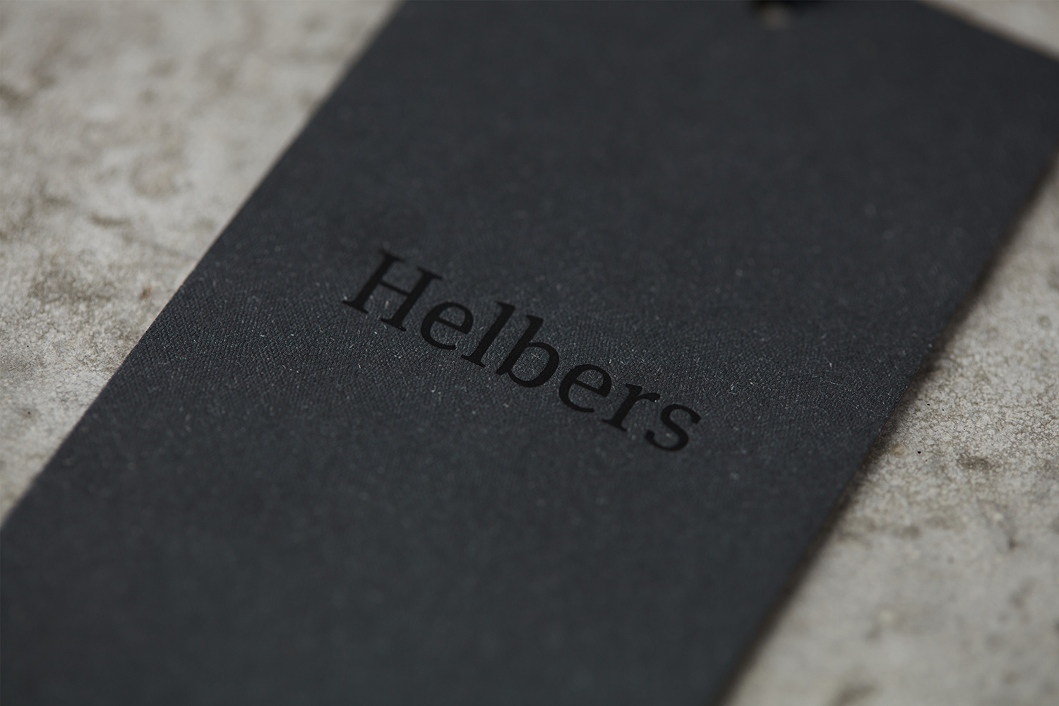 Logotype and black block foiled tags by Leeds-based graphic design studio Only for Parisian menswear label Helbers