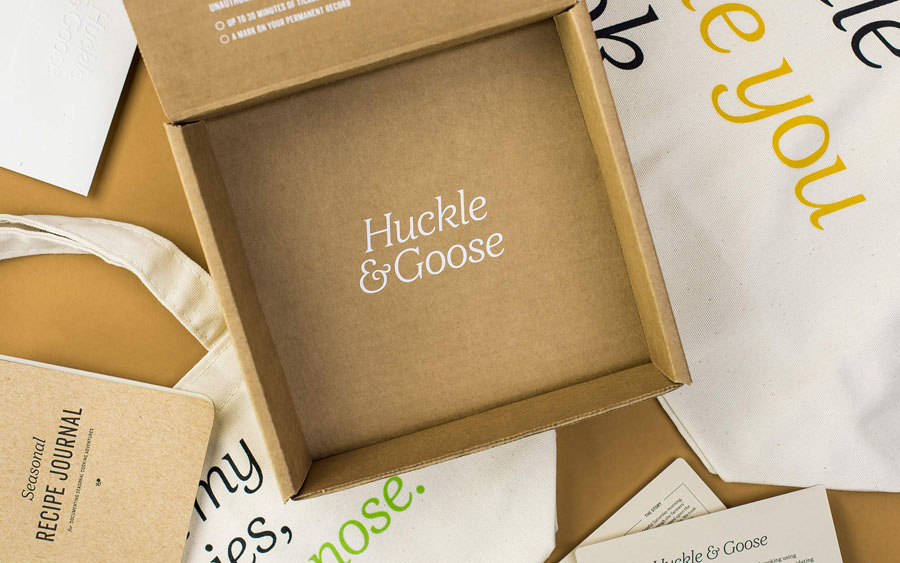 Press pack design with unbleached card and white ink detail by Cast Iron for seasonal meal advisor Huckle & Goose