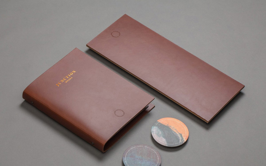 Blind embossed and copper foiled leather bound menu for Junction Moama designed by Seesaw