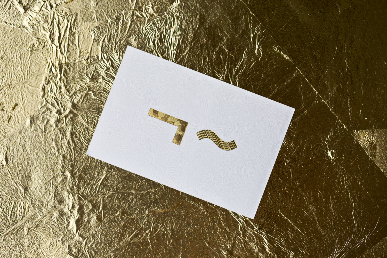 Logo and business cards with gold foil and embossed detail for UK model agency Linden Staub by Bibliothèque.