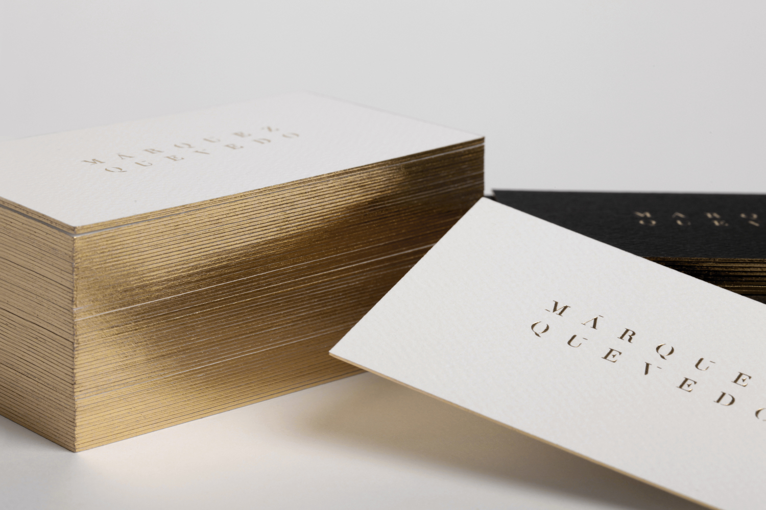 Gold block foiled business cards for architecture studio Marquez Quevedo designed by La Tortillería