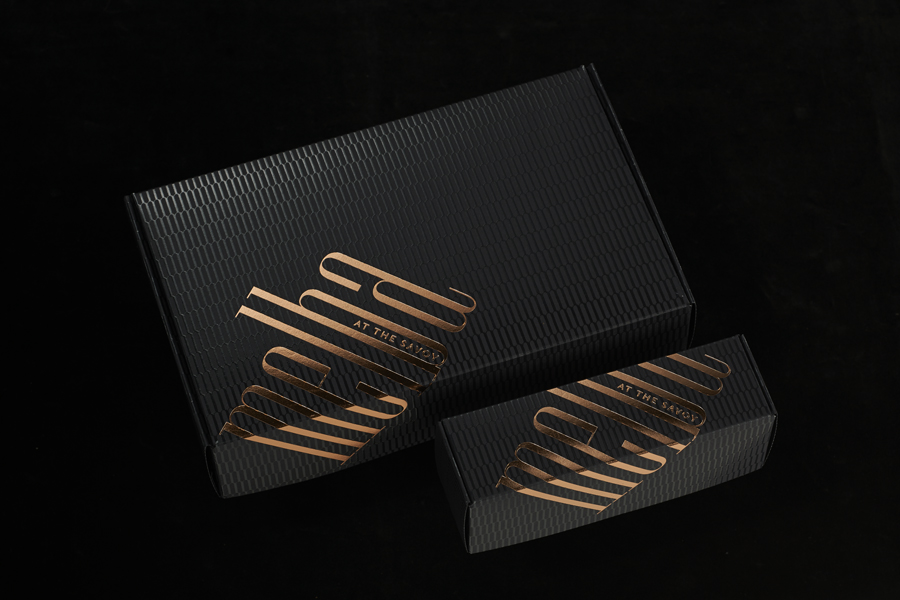 Visual identity and copper foiled pâtisserie packaging designed by Pentagram for London patisserie and cafe Melba at The Savoy