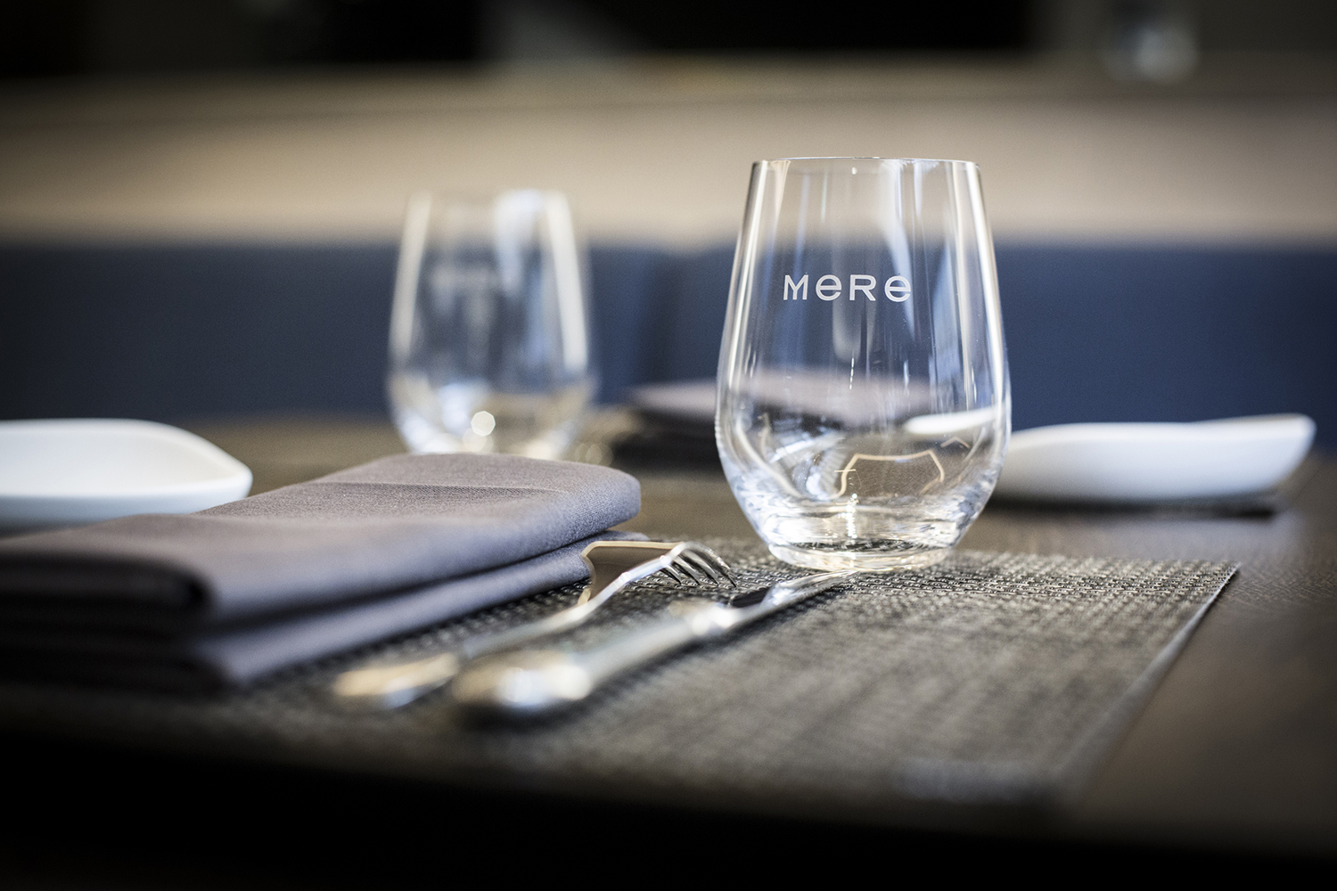 Logotype and branded glassware designed by Bibliothèque for Monica Galetti's new London restaurant Mere
