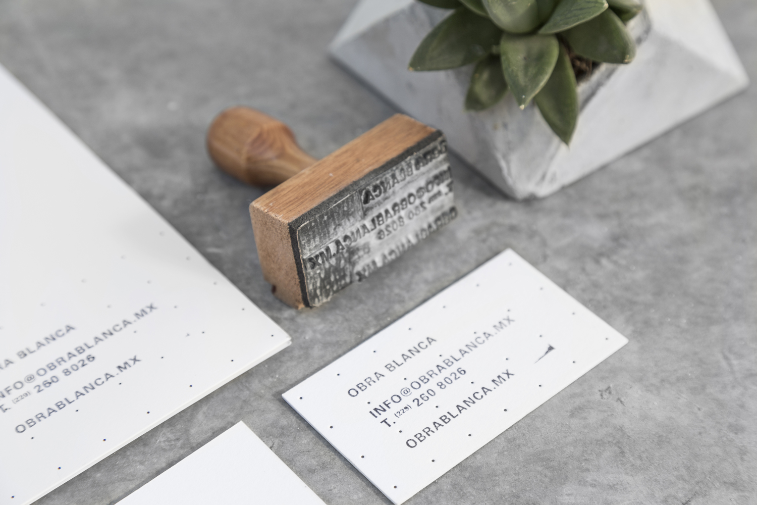 Brand identity and hand stamped business cards for Mexican architecture studio Obra Blanca designed by Savvy