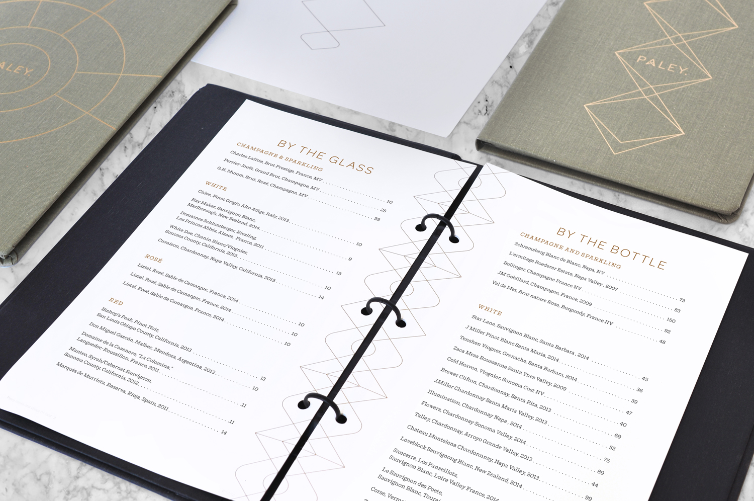 Brand identity, menus and wine lists with copper block foil detail for Los Angeles restaurant Paley designed by Mucca, United States