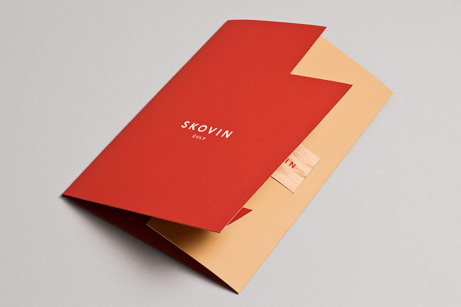 Folder design with die cut detail by Heydays for Norwegian high-end wood flooring specialist Skovin