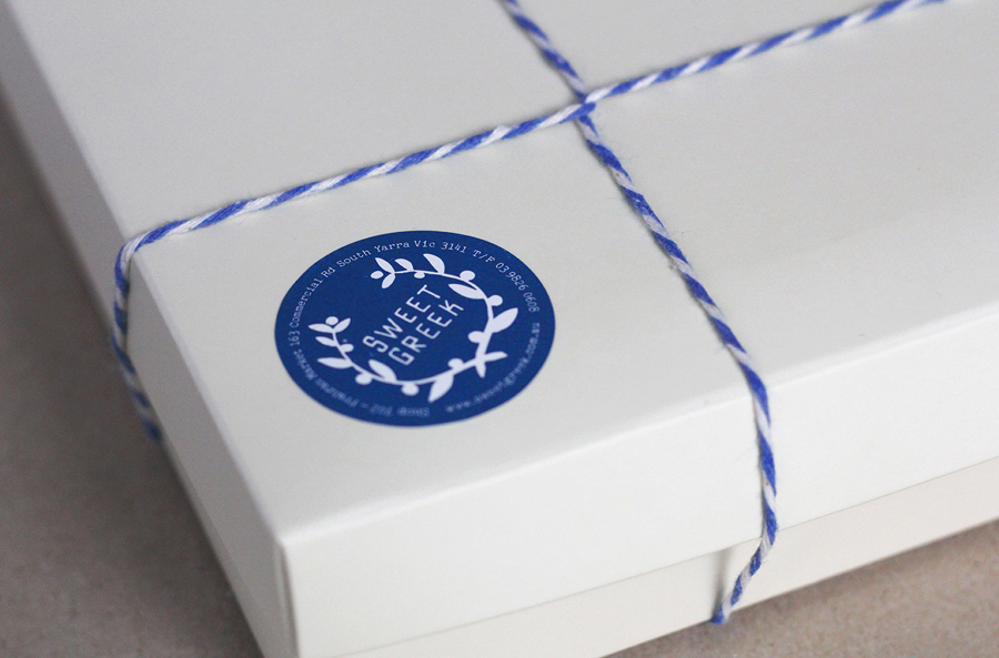 Logo, string tied box and sticker detail for Melbourne food store Sweet Greek designed by Studio Bravo