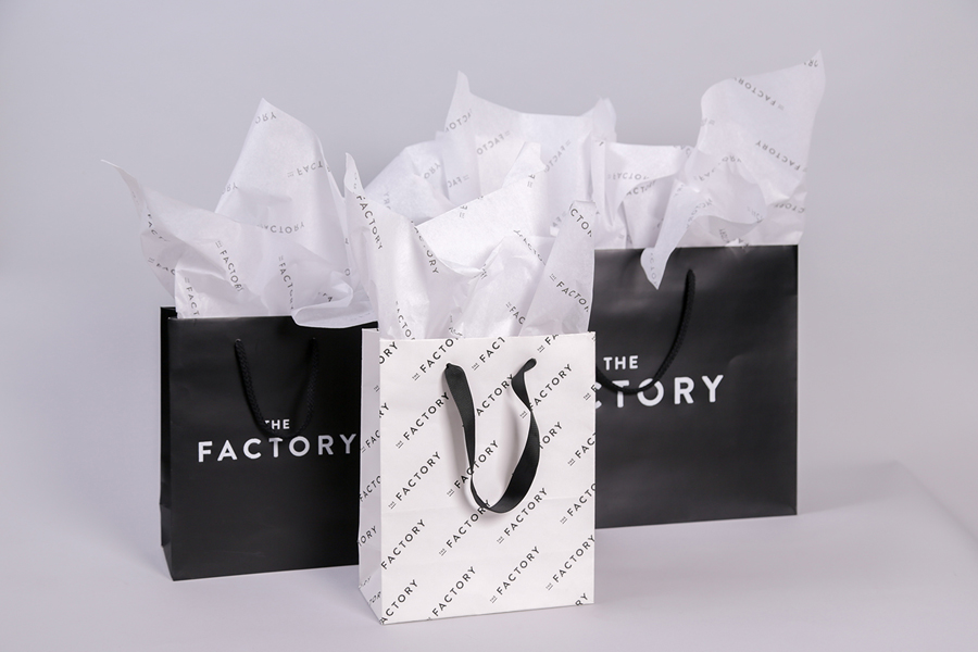 Bags and branded tissue paper for Oklahoma City fashion store The Factory graphic design studio Ghost