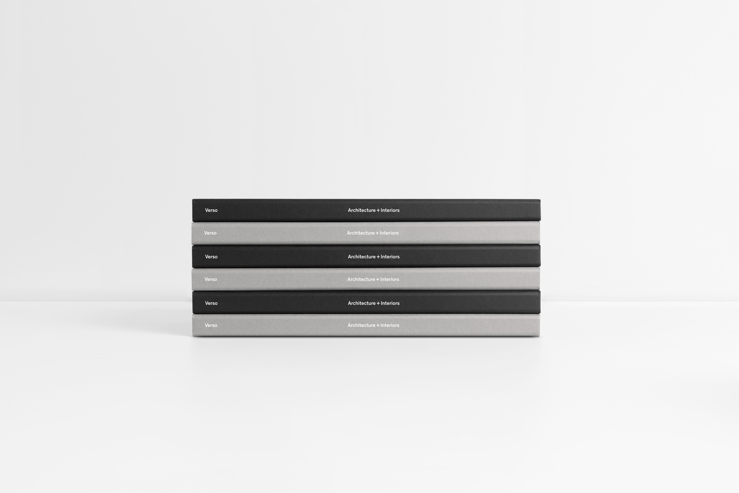Black and grey notebooks with white foil print finish by Studio South for Auckland-based architecture and interior business Verso