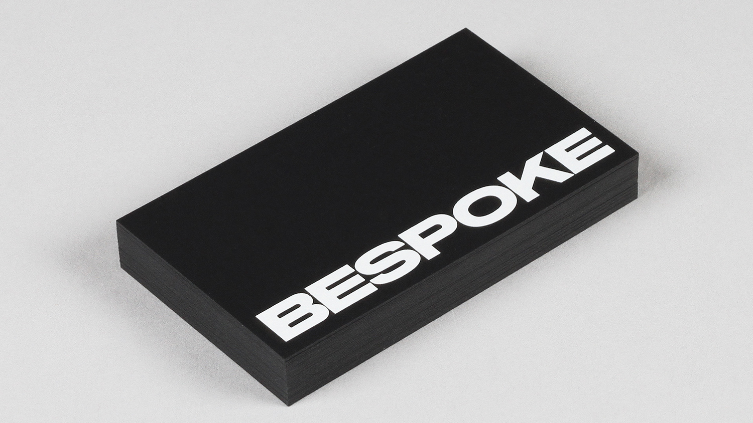 Brand identity, custom typeface and business cards by New York based DIA for boutique retouching business Bespoke