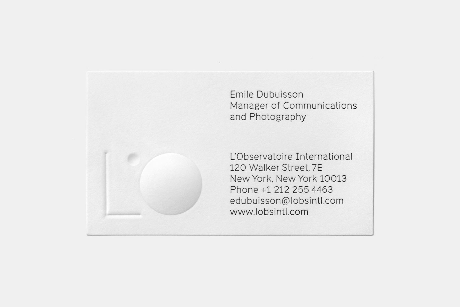 Blind embossed business card for lighting specialists L'Observatoire International by Triboro, United States