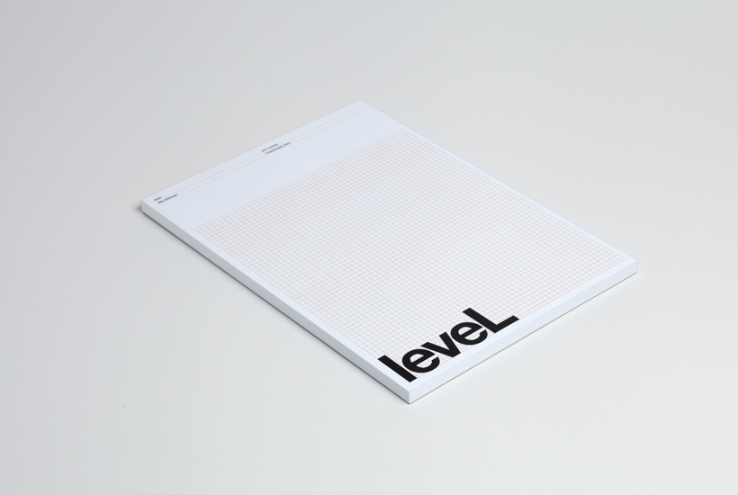 Logotype and grid notepad designed by Studio Hi Ho for Level Improvements