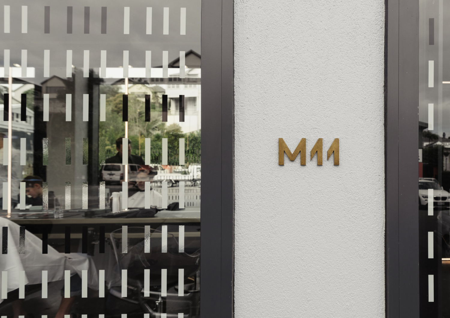 Brand identity, window graphics and signage for Auckland-based luxe salon M11 designed by Inhouse, New Zealand