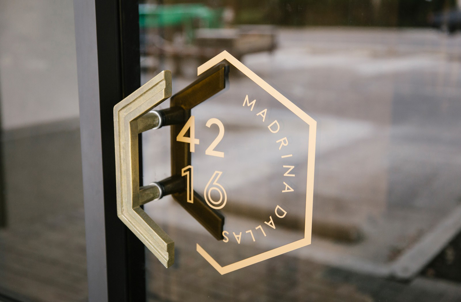 Brand identity and signage for French inspired Mexican restaurant Madrina designed by Mast