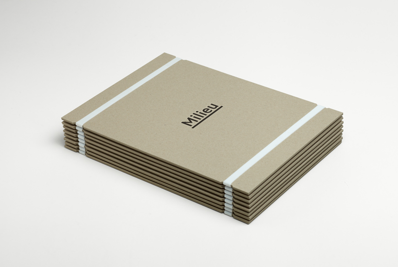 Uncoated folder with deboss logo and rubber band detail designed by Hi Ho for Melbourne-based boutique developer Milieu
