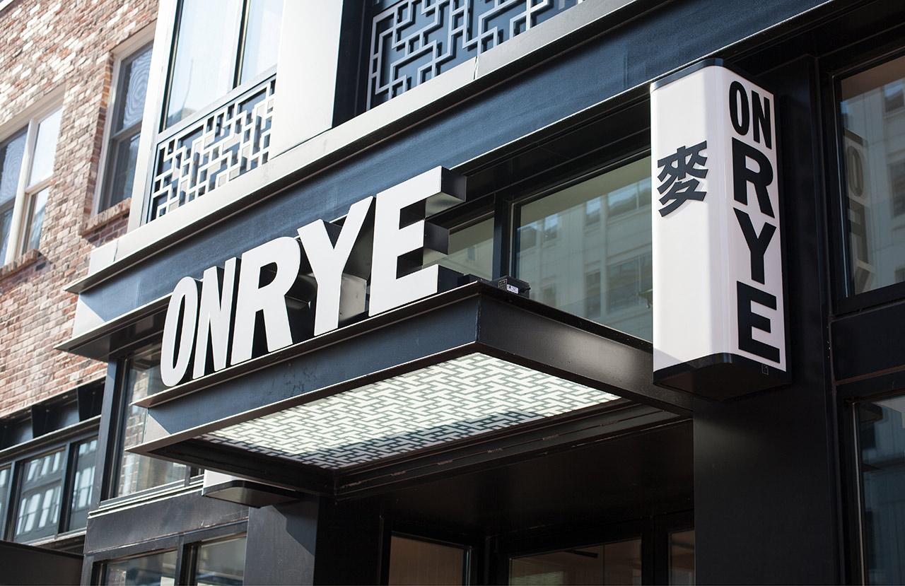 Brand identity by Pentagram and signage built by HapstakDemetriou for Washington DC sandwich shop On Rye