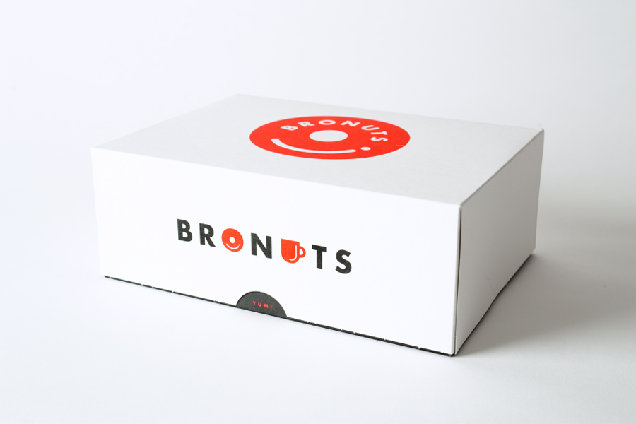 Logo and packaging for coffee and doughnut business Bronuts by Canadian graphic design studio One Plus One
