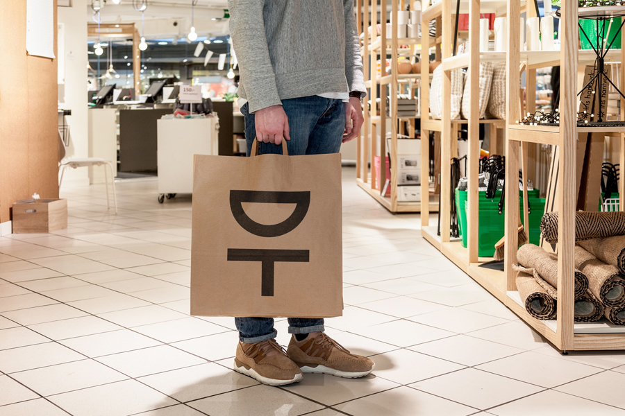 Logo and unbleached carrier bag by Kurppa Hosk for Swedish contemporary furniture, art and design curator and retailer Designtorget