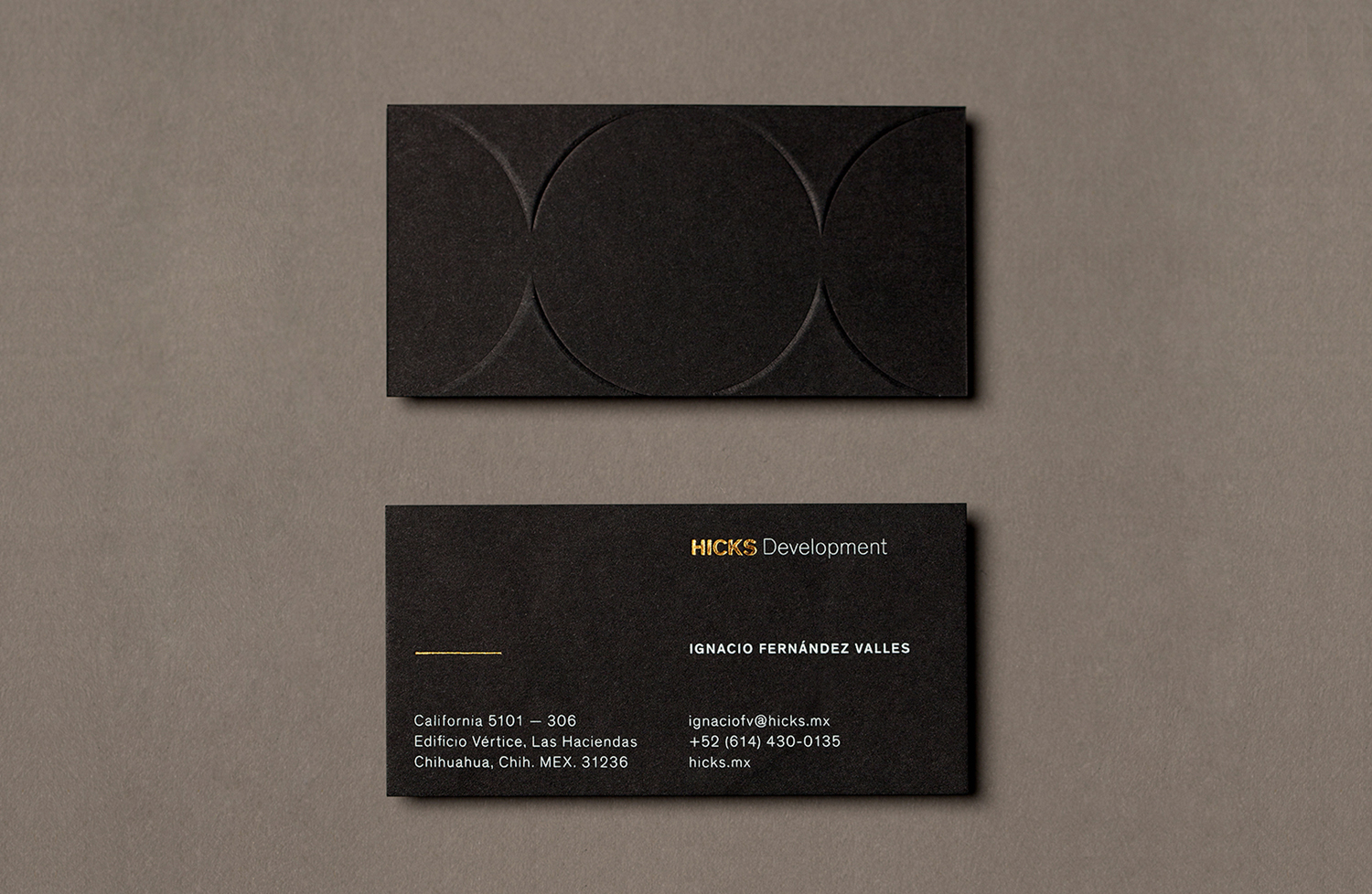 Brand identity and business cards with block foil and blind deboss detail designed by Face for Hicks Development.